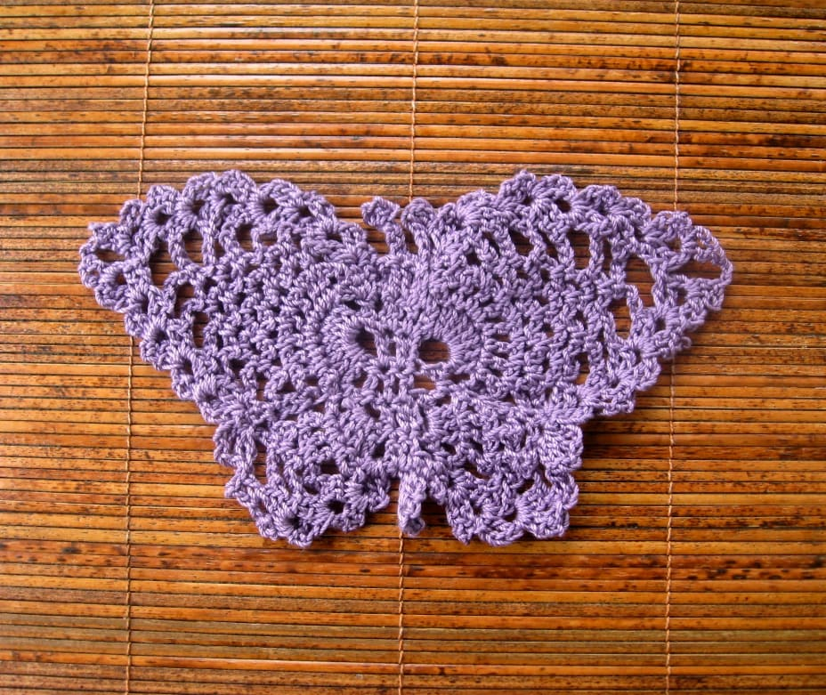 Lilac-colored crochet lace butterfly