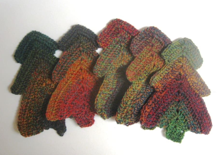 Crochet Christmas trees in a variegated green-red-yellow yarn