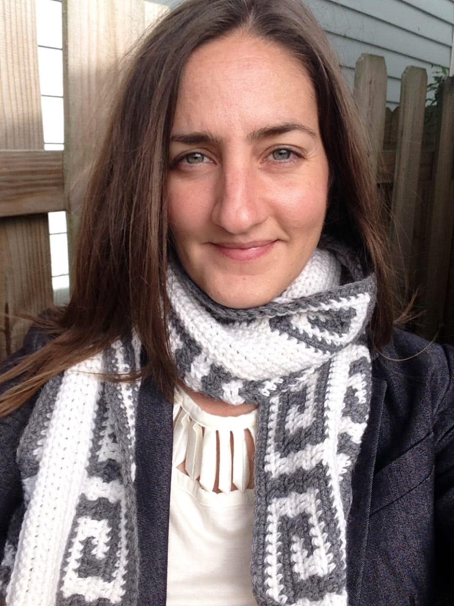 Greek woman in crochet scarf with a Greek key pattern