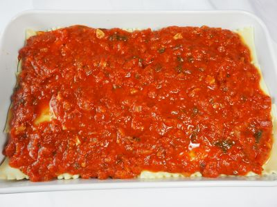 Cover the Top Layer of Noodles with Spaghetti Sauce