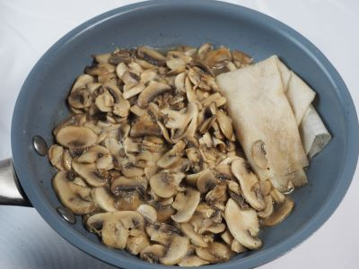 Remove the Excess Liquid from the Mushrooms with Paper Towels