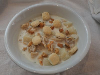 Bowl of Clam Chowder with Oyster Crackers and Fried Salt Pork Bits