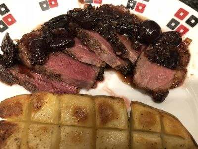 Duck Breast with Cherry Sauce Served with a Roasted Potato