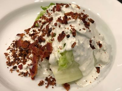Bacon Crumbled over the Top of the Lettuce Wedge