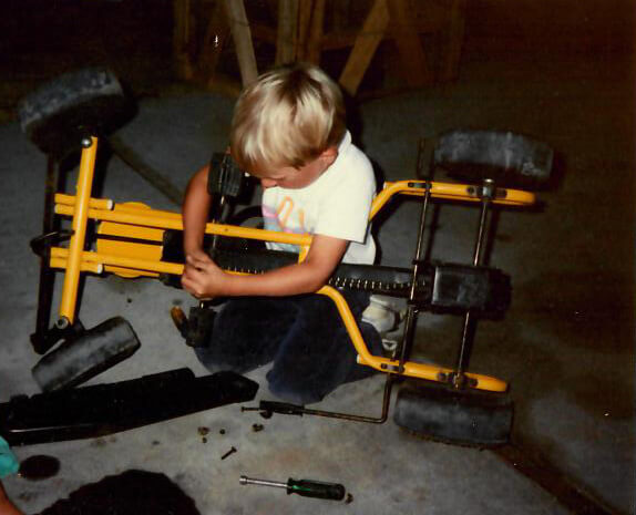 Andy at 5 years old, fixing his go-kart