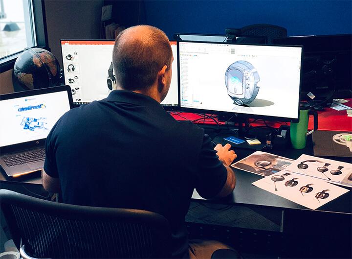 Image of Patrick Scranton bringing a sketch to life at his desk