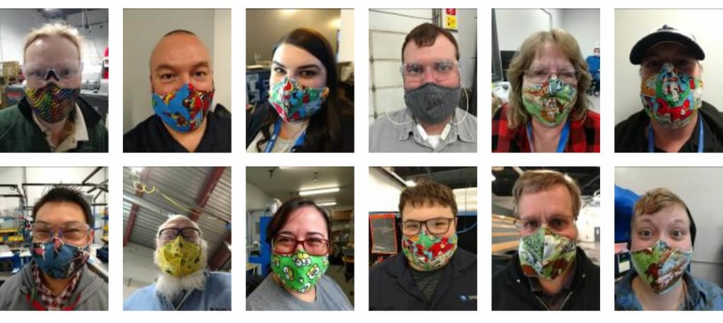sigmadesign employees with masks