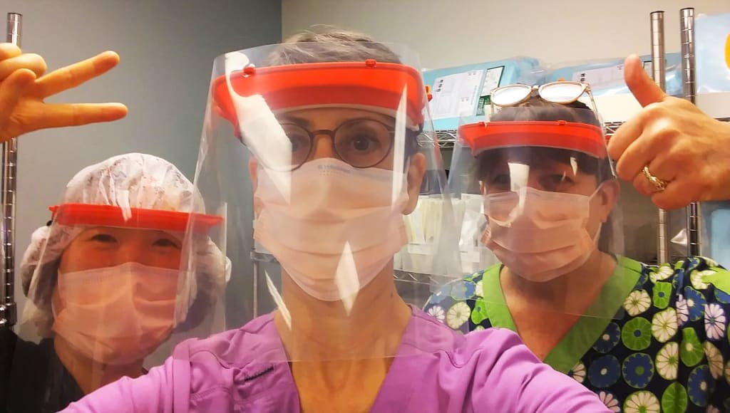 Medical professionals wearing 3D printed face shields