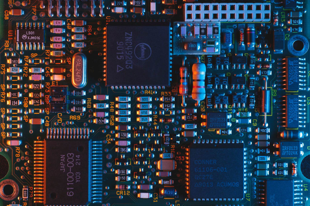 Image of complex printed circuit board. An example of a PCB that is best manufactured by a robotic system because of complexity.