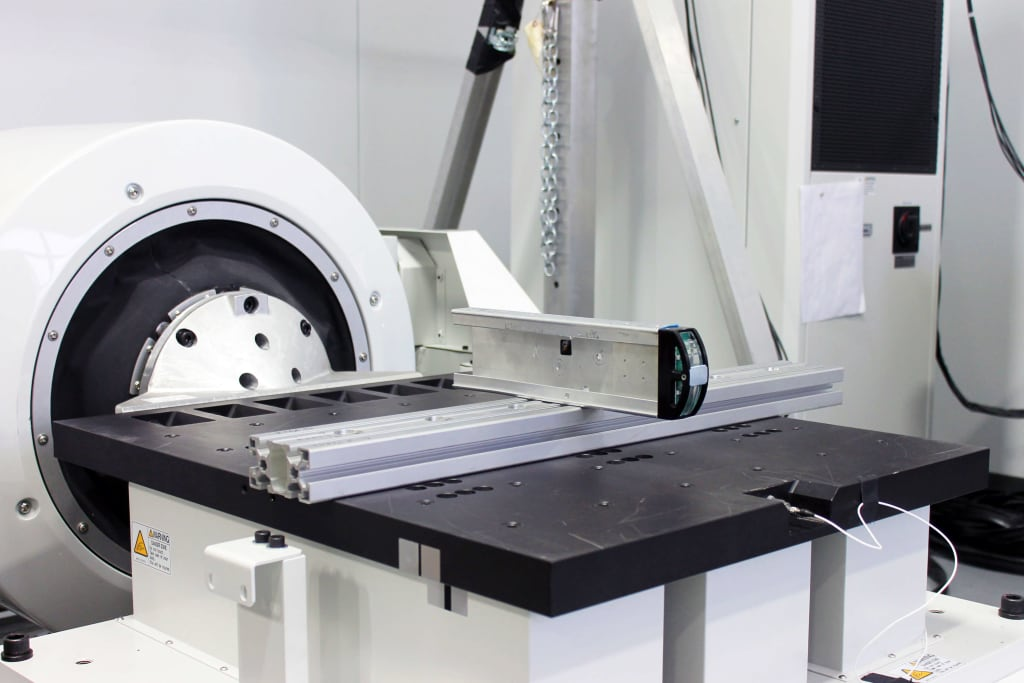 This photo shows SIGMADESIGN vibration table, custom fixture, and product being tested