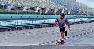 Mark Groenenboom riding one of his custom longboards at Homestead-Miami Speedway - Employee Spotlight