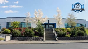 front of SIGMADESIGN headquarters building with trees in bloom