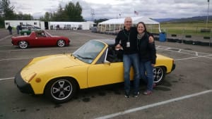 Mike with his wife and Porsche