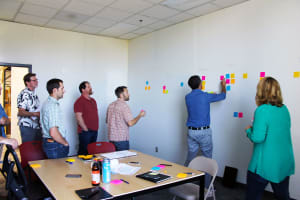 Image shows system engineer and others engaged in concept exploration