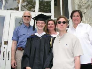 Alexia, college graduate, with family and Douglas Burnette
