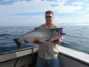 Image of Doug Hill with a large salmon in Alaska