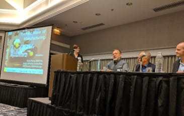 Bill Huseby speaks on panel at the Manufacturing Symposium in Portland, Oregon