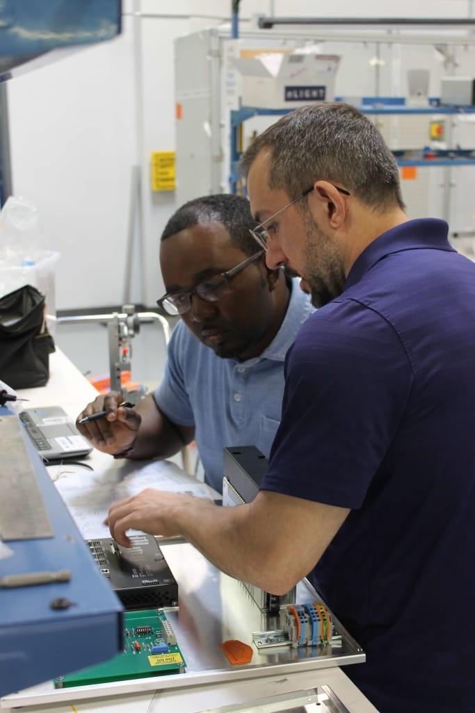 employees in the lab working together