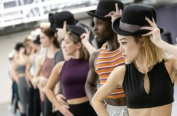 Lina Lee as Connie, Phil Young as Richie, and the cast of A Chorus Line