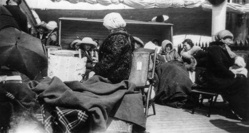 Survivors huddle on the deck of the Carpathia.