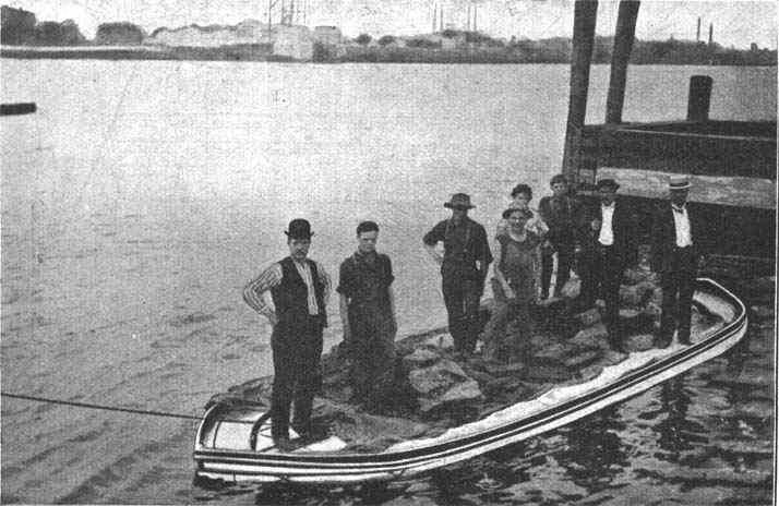A collapsible lifeboat with the sides down.