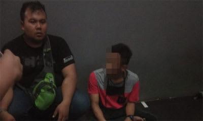 DS pakai baju merah saat diinterogasi karyawan Alfamidi Jalan Kartini Kota Siantar.