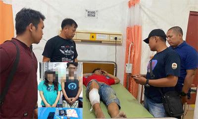 Ipan saat dibawa ke rumah sakit untuk diobati karena mendapatkan tembakan di bagian kaki (foto insert Ane dan Afri).