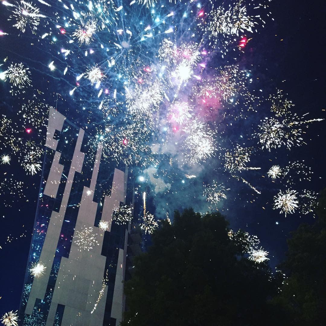 White fireworks exploding around the Ascent in Covington Kentucky