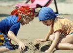 Kids building sand castles