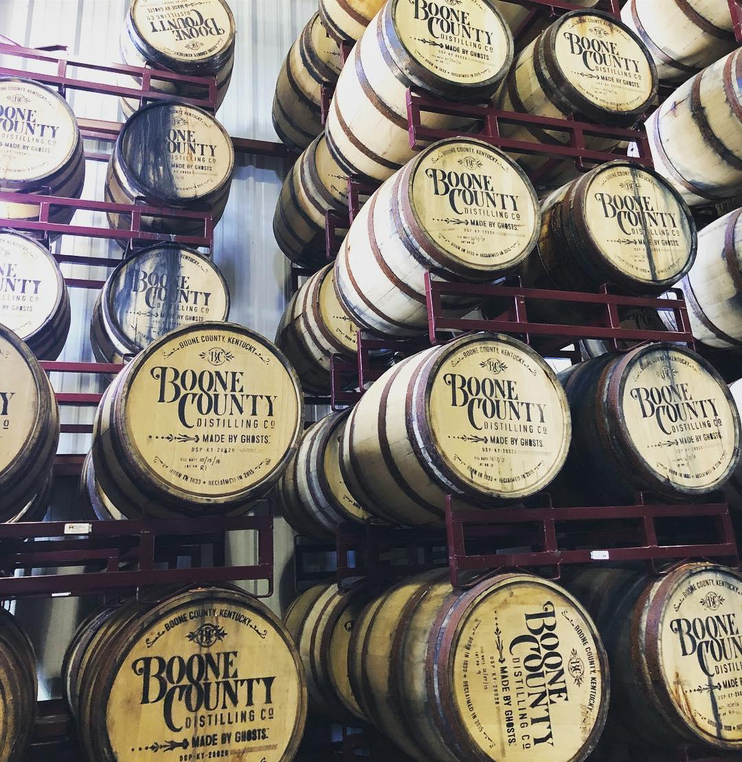 racks of boone county distilling co. bourbon barrels, stamped with their logo