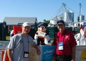 """Captain """"Mickey Mouse"""" helped educate young boaters at Empire Farm Days in 2011 with New York Sea Grant's Dave White (right) and Greg Chapman (left). Photo: Elley Brown"""
