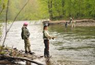 Instructor Lindsay Agness, left, will lead the fifth annual Women's Fly Fishing Seminar sponsored by the Tug Hill Chapter of Trout Unlimited and the NYS DEC June 2 and 3 in Altmar. Agness is pictured with participants at last year's seminar. (Photo by Jessica Burt, Oswego County Tourism Office.)