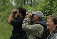 Participants at the annual Roger Tory Peterson Birding Festival on an early morning bird watch. The Birding Festival is one of many activities offered during Chautauqua in June.
