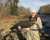 New York City attorney Emily Viglietta holds a beautiful steelhead taken last fall on the upper Salmon River in Oswego County.