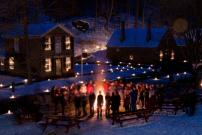 Visitors enjoy the magic of last year's Candlelight Evening in the Historic Village of The Farmers' Museum.