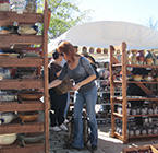 Woman Shopping for Pottery at Fort Ligonier Days