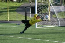 Goalie dives for the ball at soccer camp at Starfire Sports Complex