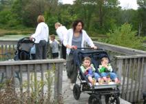 The Nature Strollers enjoy the fields and forest of the Outdoor Discovery Center.