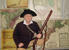 Randy Patten with some of his dozens of historic military maps.