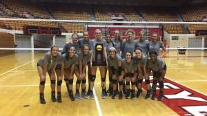 OSU Volleyball team holds NCAA Volleyball Trophy