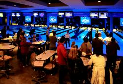 ACME Bowl people bowling in the lanes