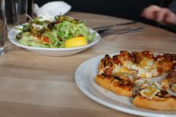 Table with bannock pizza and sliders with Manitoba pickerel
