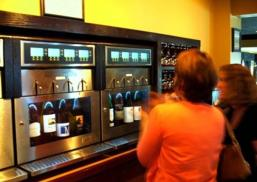 Patrons try out the new wine vending machines at Corks & More in Ithaca, where customers can dispense their own wine via vending machines.
