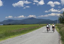 Cyclists ride towards Whiteface mountain in the Adirondacks.