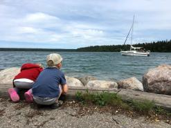 Watching a boat in Clear Lake, Wasagaming