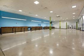 Photo of the interior of Cruise Terminal 2 featuring the check-in area