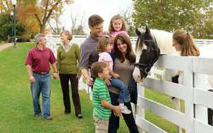 Family with Friendly Horse
