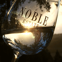Noble Estate Glass of Wine at Sunset