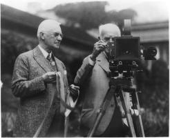 George Eastman and Thomas Edison look a first moving picture camera