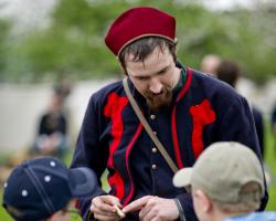 reenactors share history with children at Genesee Country Village and Museum